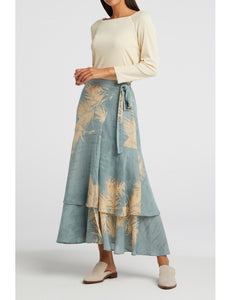 A pretty midi skirt in a sky blue with images of palm grass scattered in cream