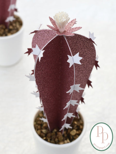 Close up of pink glitter paper cactus with white thorny spikes on the edges.