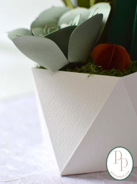 Close up of origami folded paper base made of richly textured fabriano cardstock.