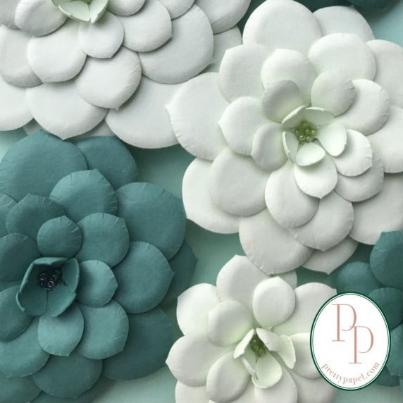 Close up of 3D paper echeveria succulent magnets in pistachio and dusty blue cardstock papers.