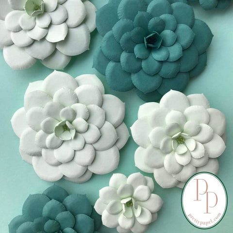 3D paper echeveria succulent magnets in pistachio and dusty blue cardstock paper.