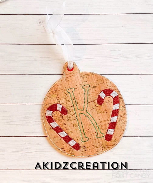 in the hoop candy cane ornament, candy cane monogram, monogram embroidery design, christmas monogram embroidery design, candy cane embroidery design, kya font embroidery design