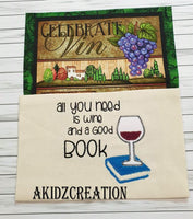wine reading pillow, reading pillow, pocket pillow, wine glass embroidery, book applique, book embroidery design, akidzcreation