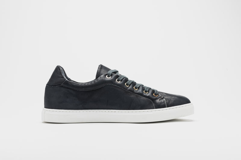 A side image of navy blue men's leather sneakers