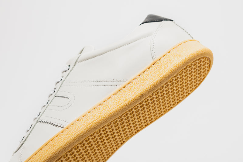 The pale tan textured sole of the Open