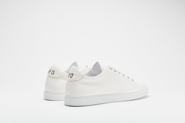 A rear image of a men's white leather sneaker with a white sole and white laces