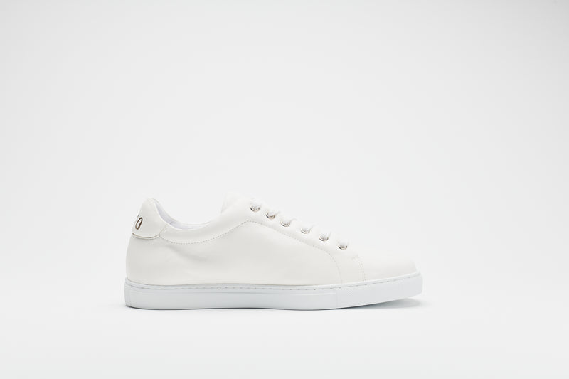 A side image of a men's white leather sneaker with a white sole and white laces