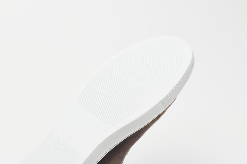The white sole of a men's leather shoe