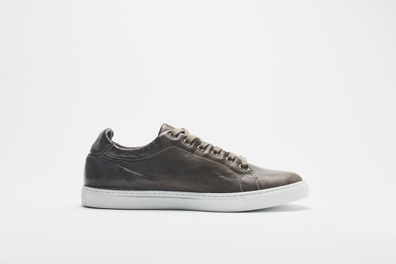 A side image of a men's grey-brown leather sneaker, on a white sole and with light grey-brown laces