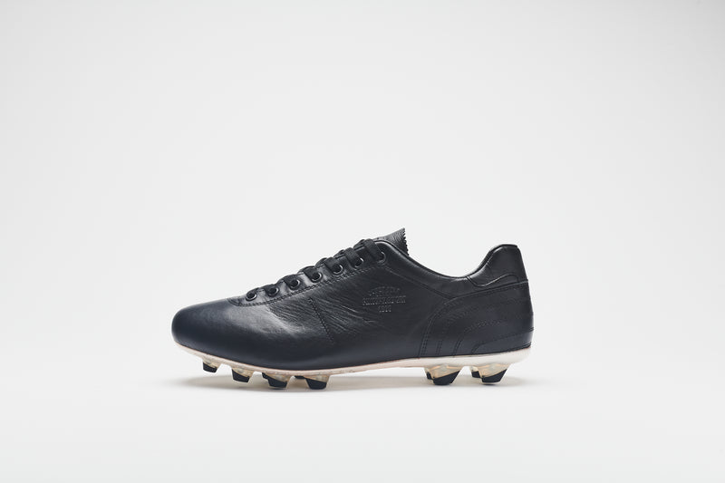 A side image of a men's leather football boot with a white sole and black studs