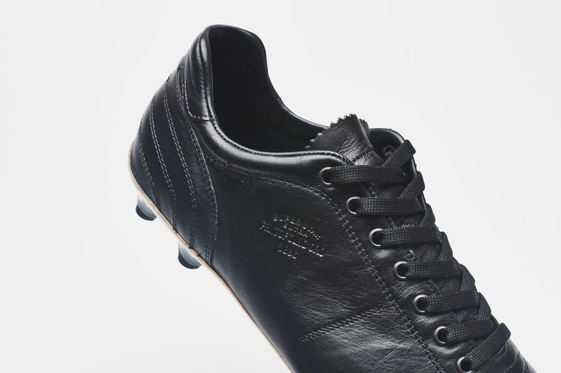 Black laces on a black men's leather football boot