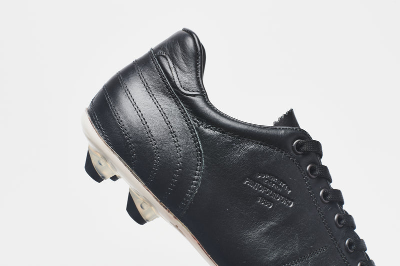 The smooth heel section of a men's black leather football boot