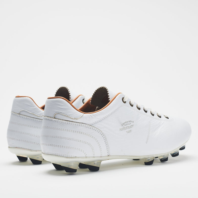 The heel of an all-white men's leather football boot with black-tipped studs and a tan lining