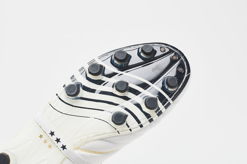 The sole of a men's leather football boot, showing black-tipped studs and a black wave graphic for detail and style