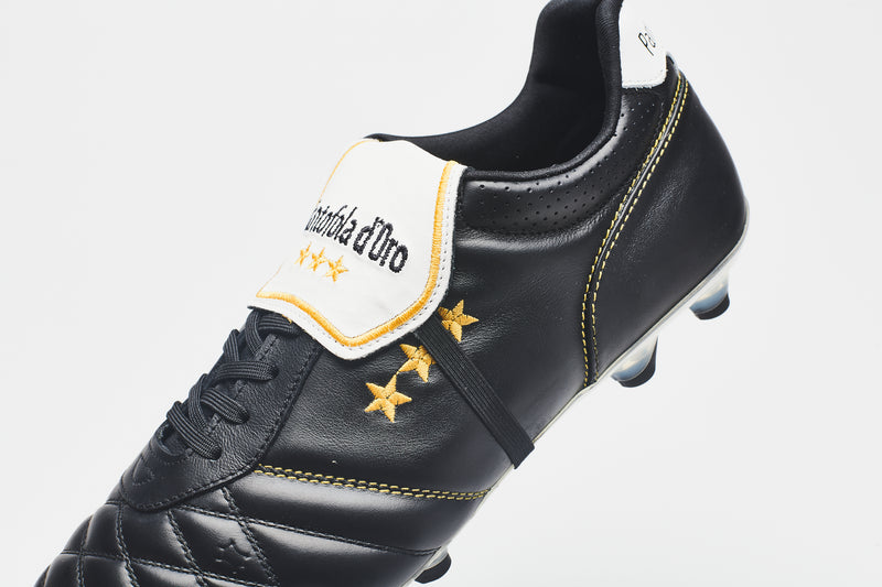 A close-up image of a men's leather football boot in black with a white tongue