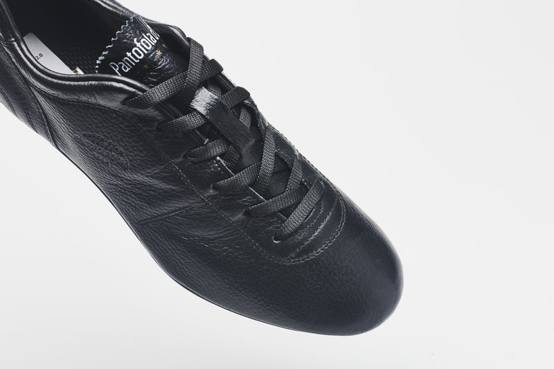 Black laces on a men's all-black leather football boot