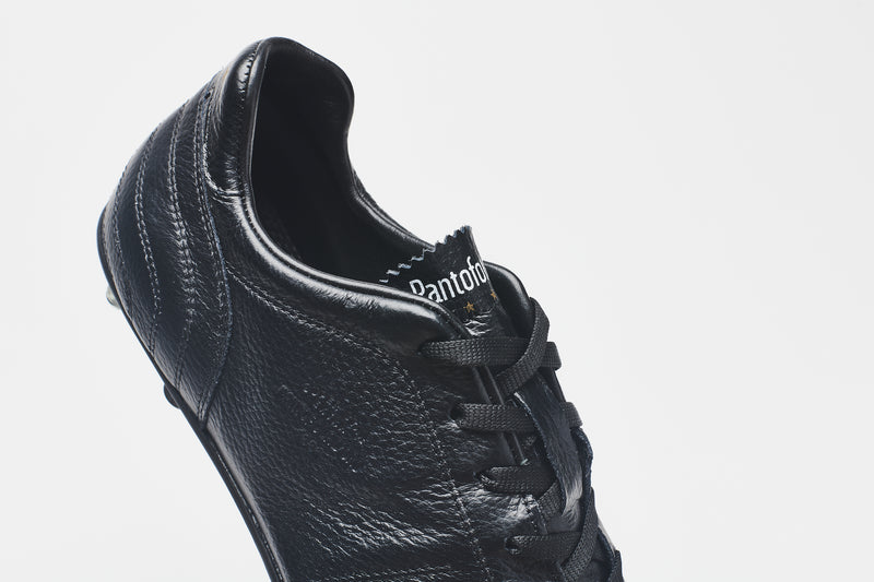 The black lining of a men's all-black leather football boot
