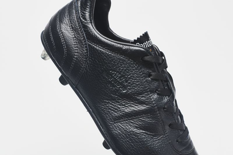 A side image of the heel section of a men's all-black leather football boot