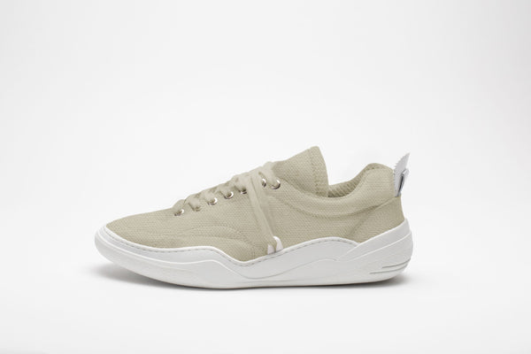 Side profile of men's leather trainers in cream