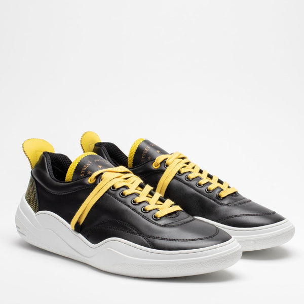 Pair of men's leather trainers in black, yellow and white