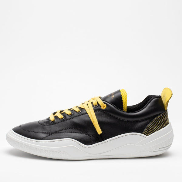 Side image of men's leather trainers in black, yellow and white