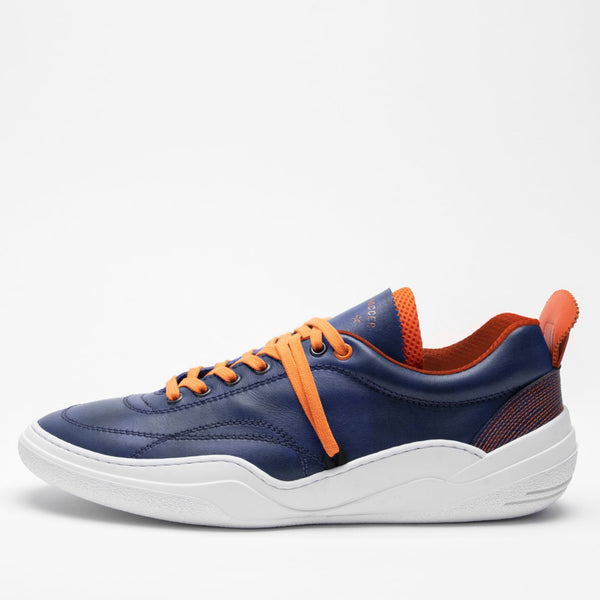 Side profile of men's leather trainers in navy blue, orange and white