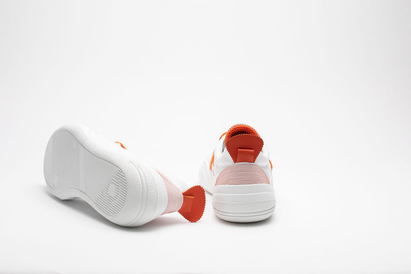 Rear image of men's leather trainers in orange and white