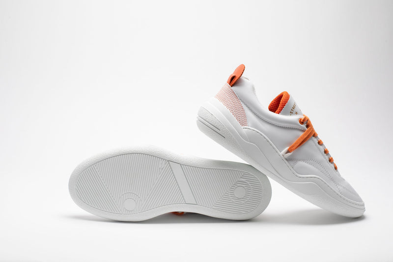 Sole and side profile of men's leather trainers in orange and white