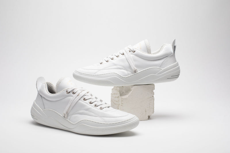 Styled image of men's leather trainers in all-white