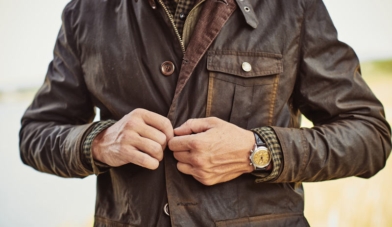 buttoning the Woodside Waxed Jacket