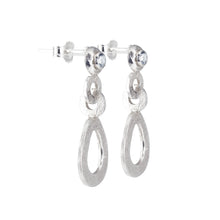 Load image into Gallery viewer, A side view image of the hand-textured silver dangle post earrings.