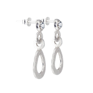 A side view image of the hand-textured silver dangle post earrings.