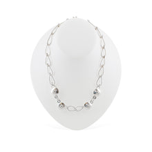 Load image into Gallery viewer, This Bella Necklace is draped over a white mannequin. It is a hand-wrought teardrop chain with four circular balls positioned at the  front of the necklace.