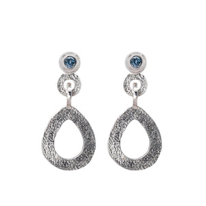 These hand-textured silver dangle post earrings features 3mm denim blue Montana sapphires.