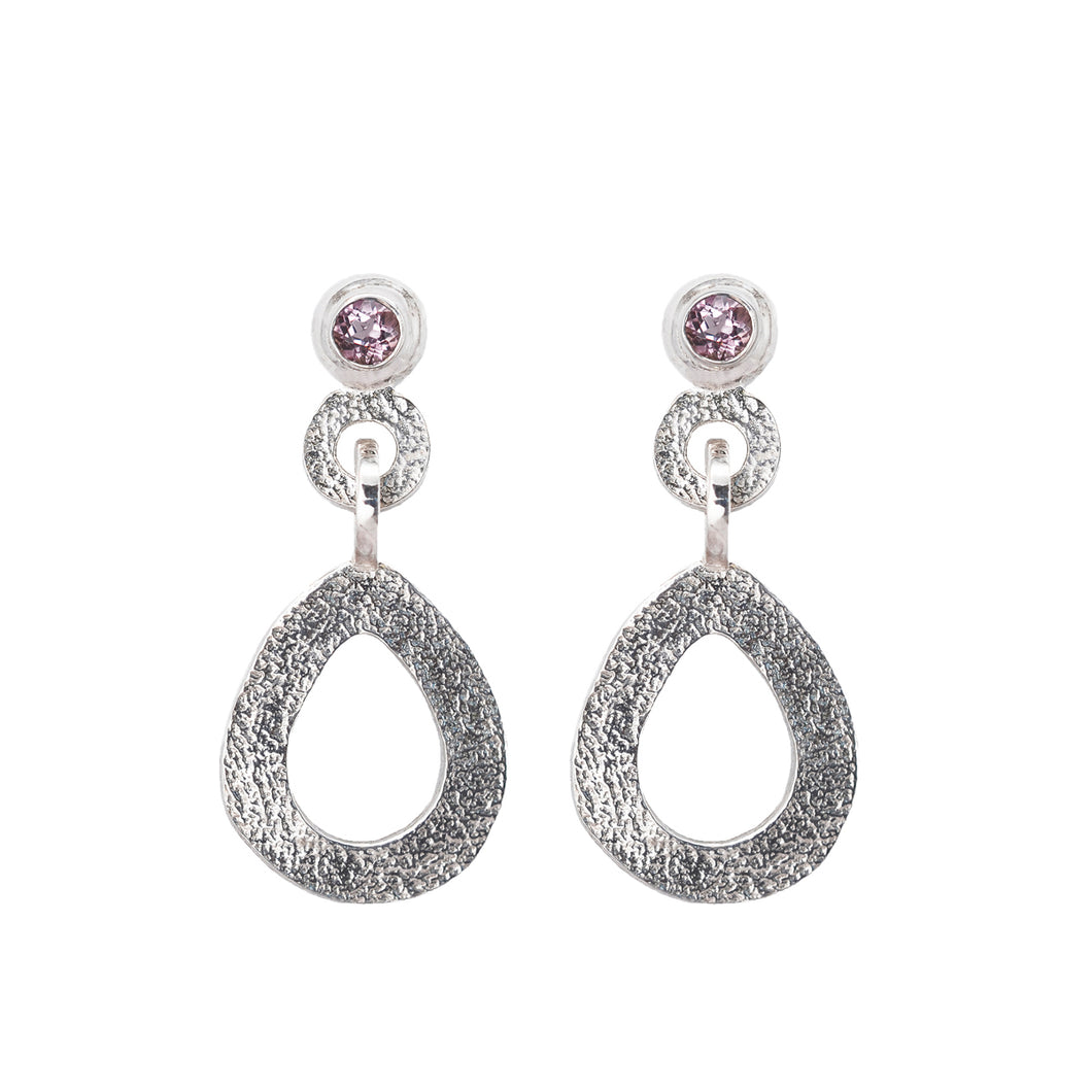 These hand-textured silver dangle post earrings features 3mm light pink topaz gemstones.