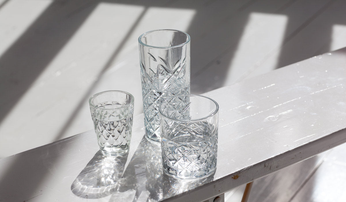 Crystal glasses reflecting the sun. Healthy detox habits.