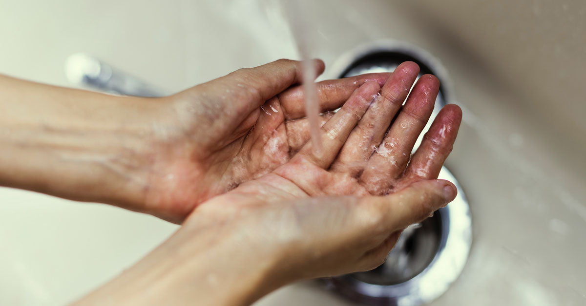 Washing hands in sink, synthetic fragrance