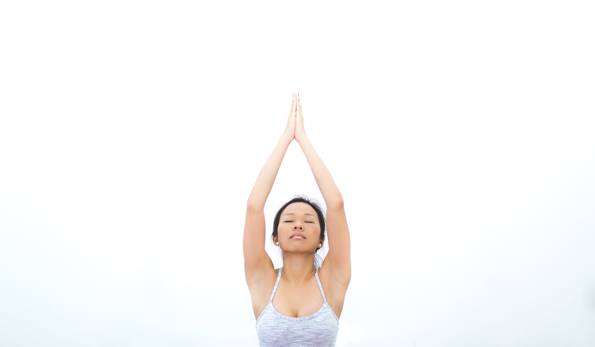managing stress during a crisis woman meditating in white background
