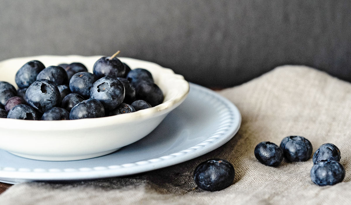 top 7 super foods for perfect skin  organic blueberries in a bowl