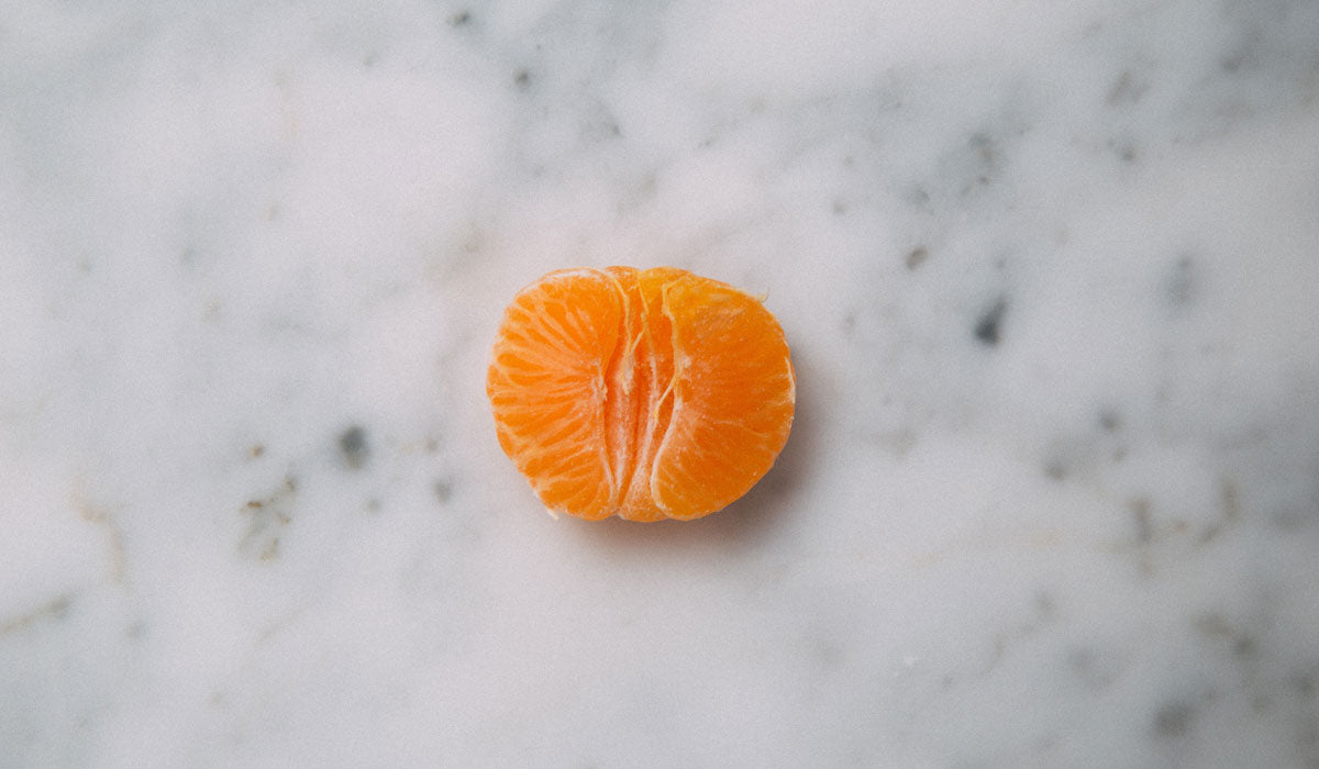 vitamin c benefits orange in grey background