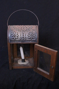 a handcrafted reproduction an early 19th century American country style primitive lantern.  It is not electrified and fitted for candles