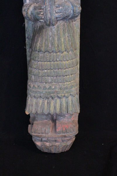 carved wood and painted Indonesian statue