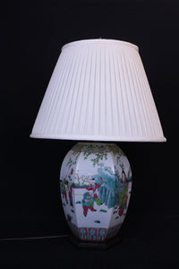 Early 20th century Chinese porcelain bulbous hexagonal form lamp with numerous figures in a landscape.