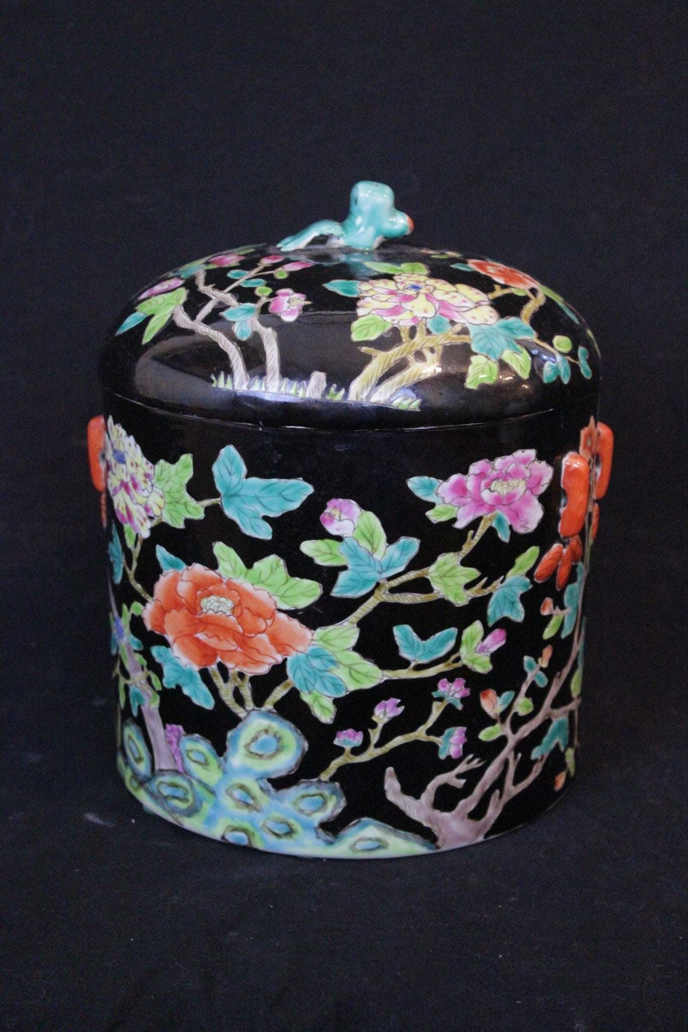 Chinese covered jar Early 20th century cylindrical form with domed cover in good condition.  Famille Noir decoration with details