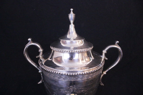 English silver-plate tea urn. Neo Classic form with removable domed cover. Monogrammed 'RMH'. Victorian period, circa 1870's