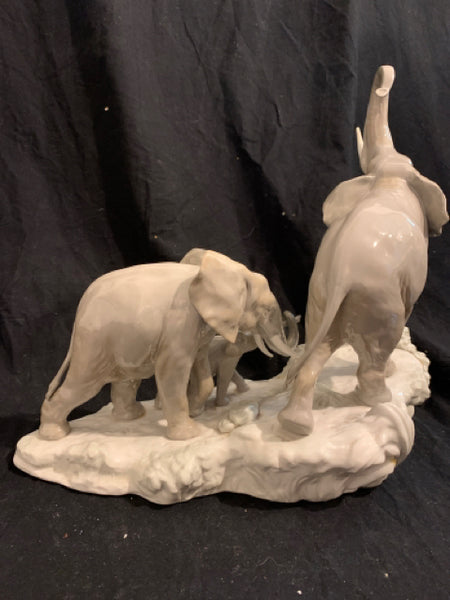 "Lladro Porcelain Elephant Family Group, title "" Elephants Walking"".  This is an authentic late 20th Century porcelain figurine, made in Spain.  It is in good condition and 16"" wide x 14"" tall."