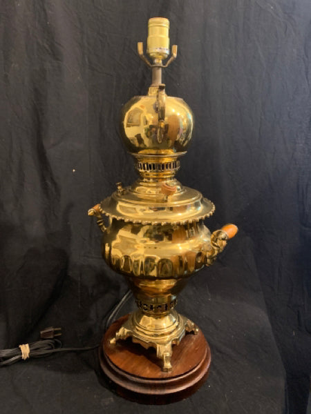 "Brass Samovar Adapted as a Lamp. This is an early 20th Century Brass Samovar lamp.  It is made in Turkey and has a hallmark stamp. There are minor dents and scrapes, and the electrical components are not guaranteed.  The Samovar is 19"" tall."