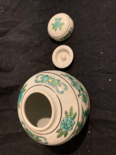 "Ginger Jar with Bird Design. This is a mid 20th Century Asian Traditional reproduction porcelain, made in China.  It is in good condition, there is intentional crackle glaze, and it is 6"" tall x 4.5"" wide."