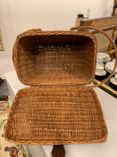 "Wicker Covered Basket.  This is an authentic circa 1960s traditional wicker covered basket.  It is in good condition, and is 19"" wide x 16"" tall with the handles down."
