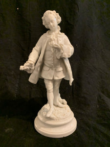 "Rococo Porcelain Figurine.   This is an authentic Late 19th Century European Rococo Figurine.  It is in good condition and 10"" tall."